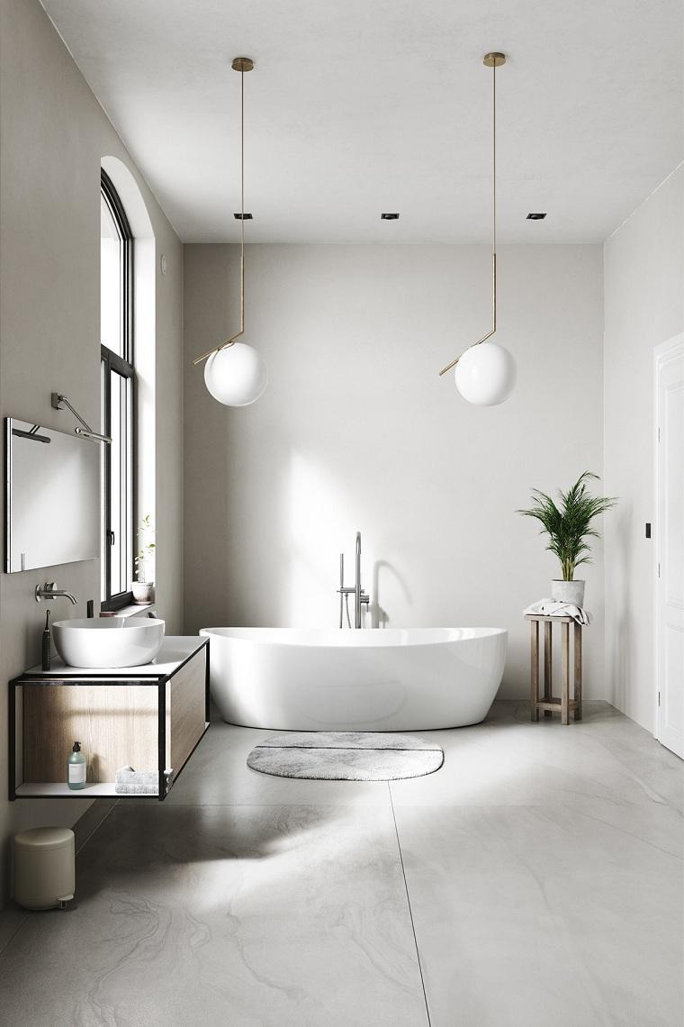 Come arredare un bagno, sala da bagno con vasca, mobile di legno sospeso con lavabo da appoggio