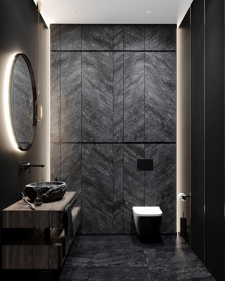 Sala da bagno con pareti rivestite in piastrelle nere, rivestimenti bagni esempi