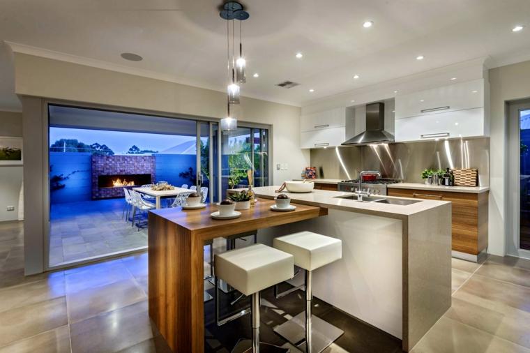 open space arredato con un esempio di cucine moderne con isola a forma di l