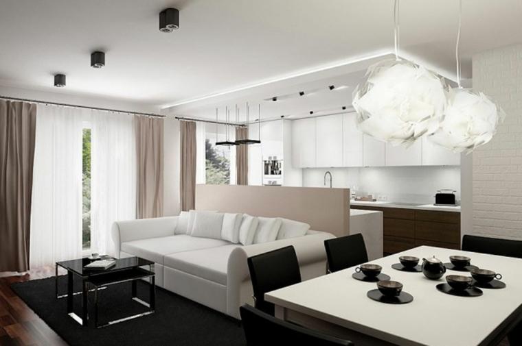 arredamento cucina salotto open space, mobili cucina pensili bianchi, divano e tavolo bianchi. tavolino da caffè nero
