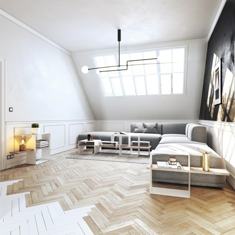 esempio per arredare mansarda open space, zona living con divano angolare grigio e parquet
