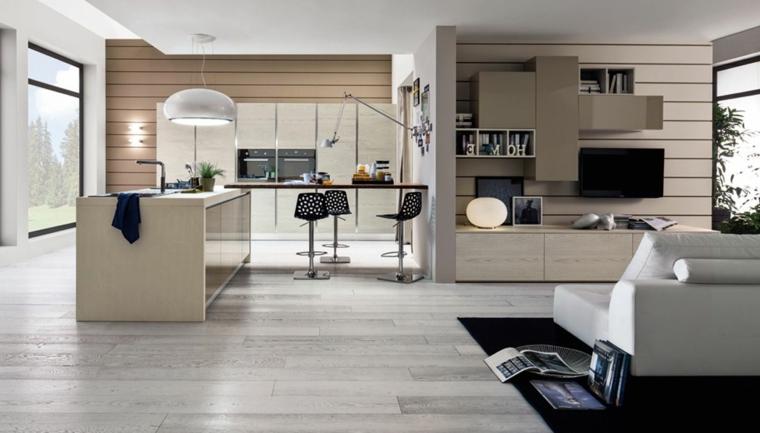 ambiente unico con cucina e soggiorno parzialmente diviso da un parete, arredamento chiaro, tappeto nero