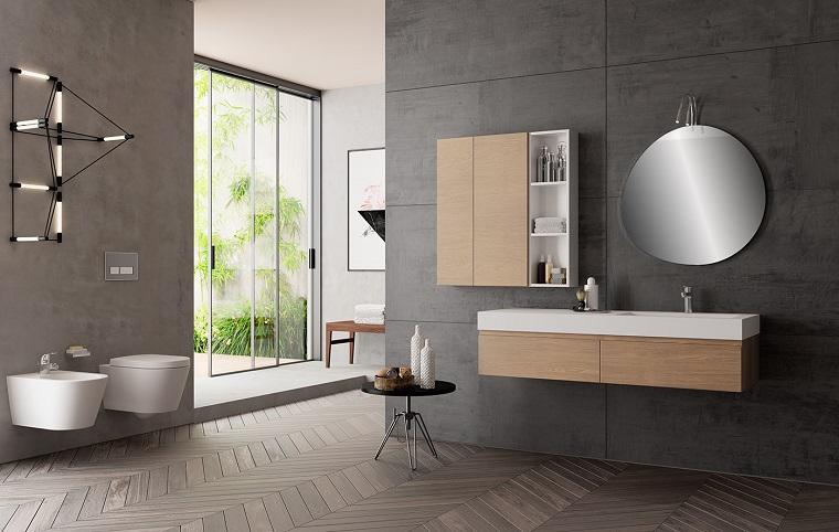 Come arredare un bagno moderno con mobili di legno sospesi e sanitari bianchi