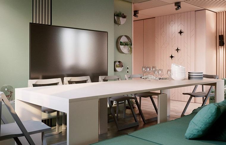 Soggiorni moderni che si trasformano in sala da pranzo, divano verde e un grande tavolo bianco con sedie