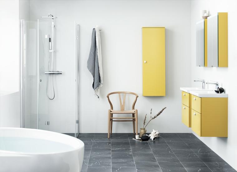 Cabina doccia di vetro e casca forma ovale, arredare un bagno con mobili sospesi di colore giallo