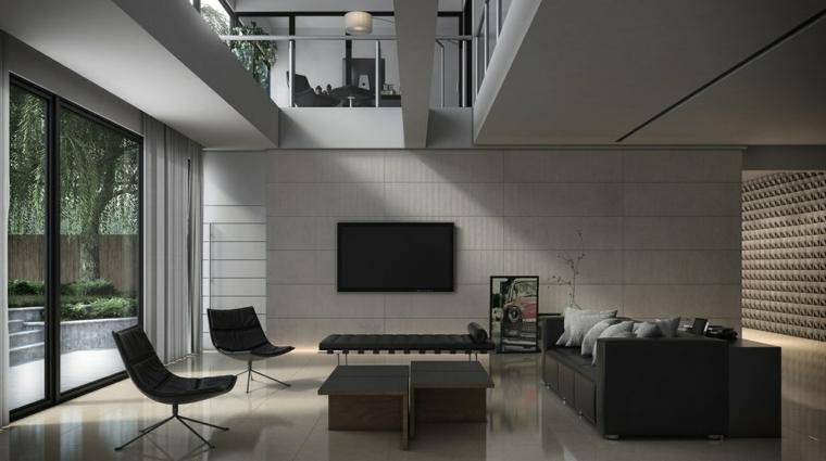Idee arredo casa e un soggiorno moderno con divano e poltrone di pelle nera