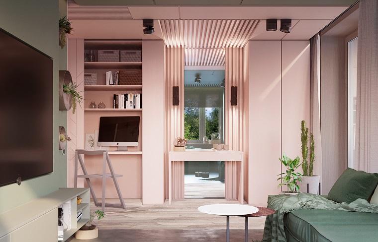 https://archzine.it/wp-content/uploads/2018/05/mobili-soggiorno-colore-rosa-legno-divano-verde-tavolino-rotondo-tv-scrivania-mensole-computer.jpg