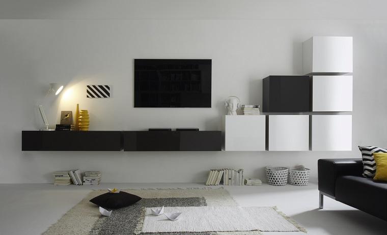 Soggiorni moderni e un'idea con mobili sospesi in bianco e nero, pavimento parquet con due tappeti di diverso colore