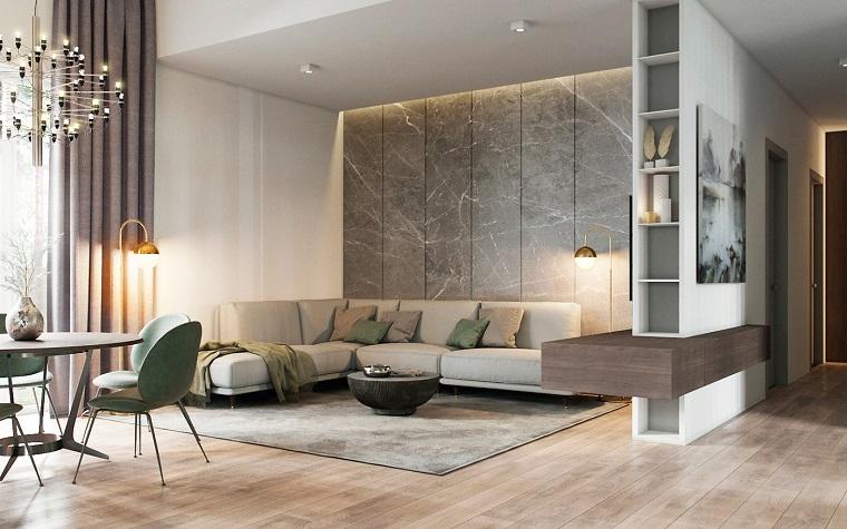 Arredare salotto e sala da pranzo insieme con un divano di colore beige e tavolino rotondo