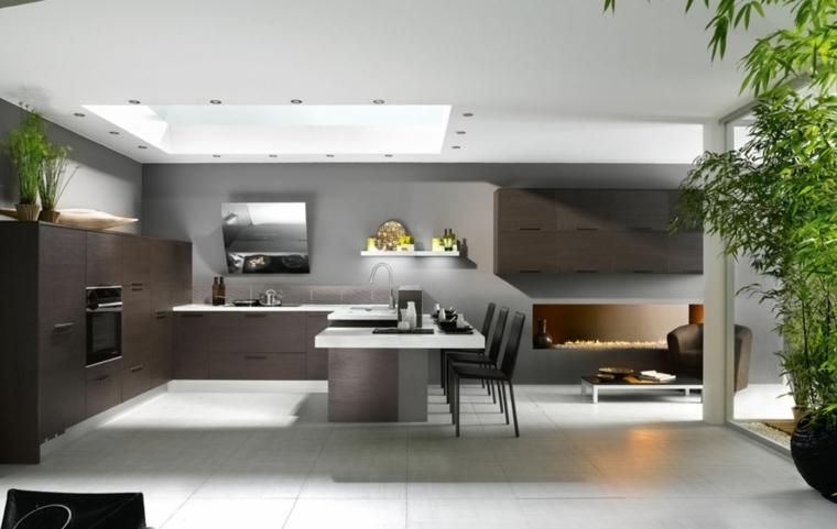 contemporanea soluzione per arredare un open space con cucina con penisola, poltrona e tavolino basso