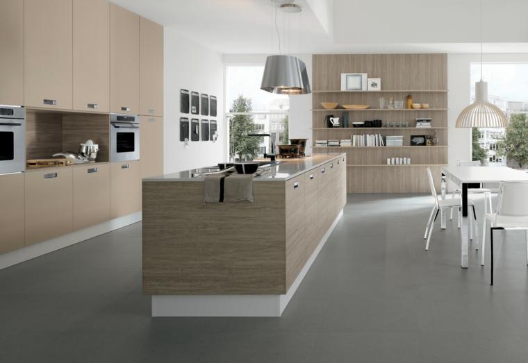 open space con cucina contemporanea dal design essenziale con mobili a parete e isola