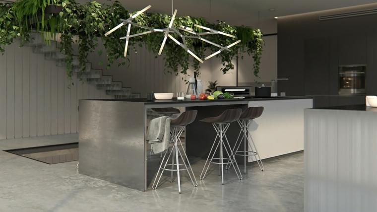 illuminazione originale sopra l'isola cucina attrezzata con tavolo e zona preparazione pranzo