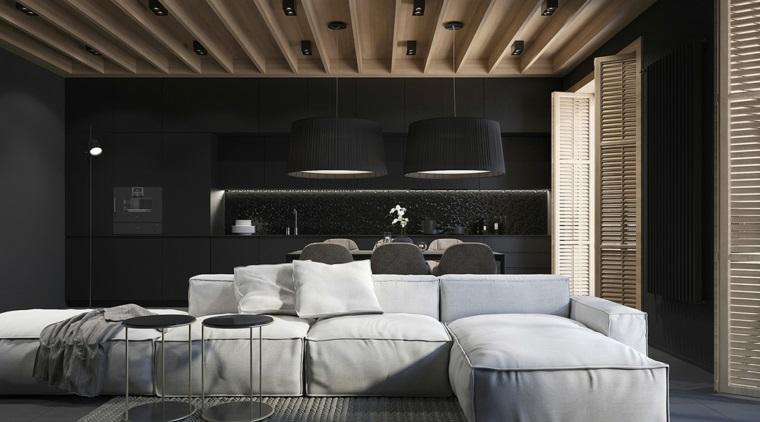 Arredamento soggiorno moderno con una cucina nera e divano bianco, due tavolini di metallo