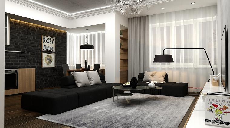 Soggiorni moderni con cucina, divano in tessuto con penisola di colore nero in abbinamento al tappeto grigio
