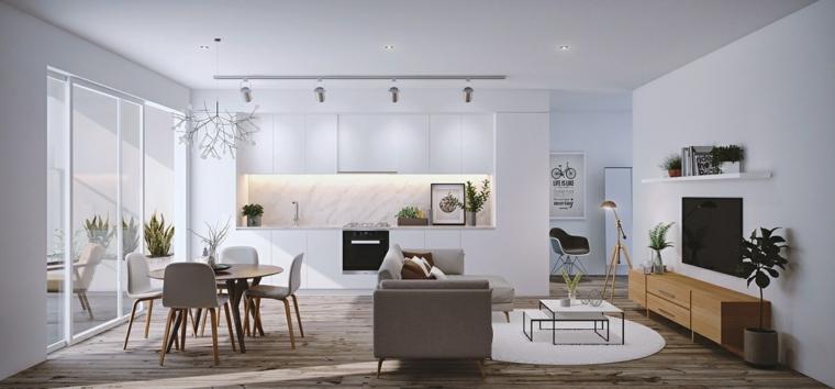 Zona giorno con soggiorno, cucina e sala da pranzo, pareti bianche e pavimento di legno parquet