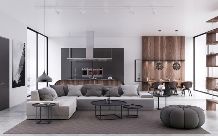 Divano angolare di colore grigio in abbinamento ai tavolini bassi neri di metallo