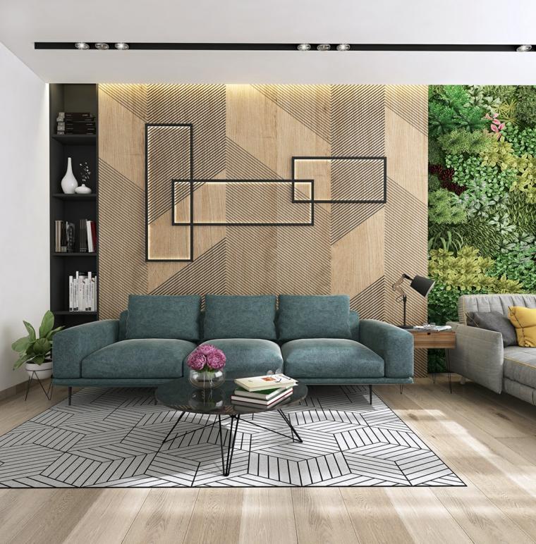Zona giorno arredata con un divano blu e tavolino rotondo, parete di legno con piccola libreria