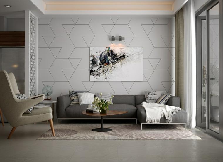 Salotto moderno con una parete grigio chiaro e forme geometriche con quadro al centro
