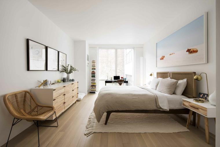 pareti tortora chiaro camera da letto con pavimeto in laminato decorare con quadri sulla parete