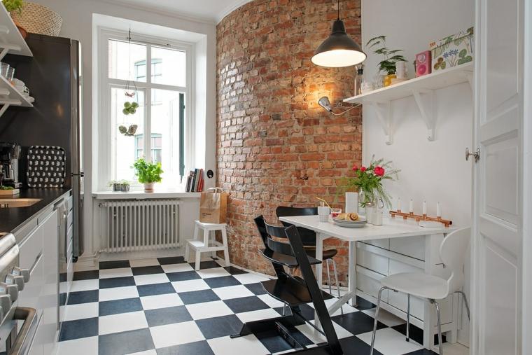 cucina con mobili bianchi e pavimento con piastrelle bianche e nere e pareti in pietra