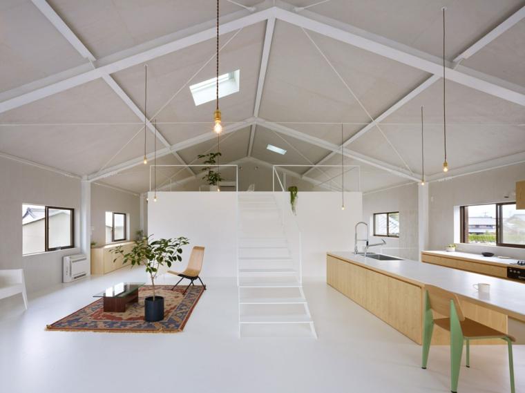 come arredare mansarda open space con soppalco, pavimento, pareti e soffitto bianchi, cucina in legno