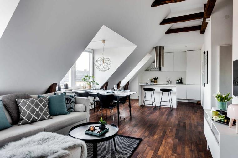 cappa tonda in acciaio, mobili della cucina bianchi, divano e cuscini grigi, mansarde moderne