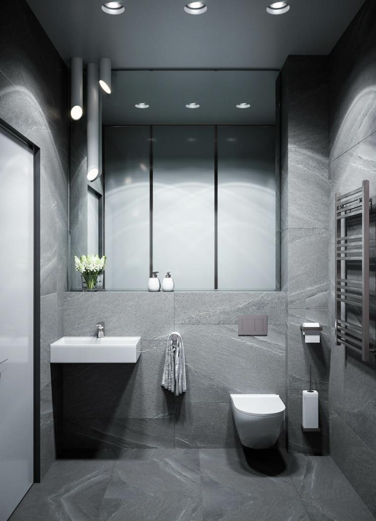 Bagni piccoli e un'idea con sanitari sospesi e pareti con piastrelle colore scuro effetto pietra