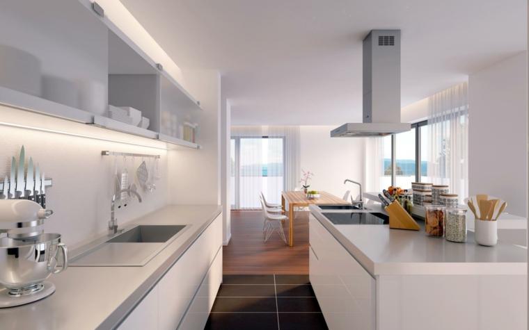cucina stretta e lunga arredata con mobili bianchi lineari e zona giorno con tavolo in legno,open space moderni