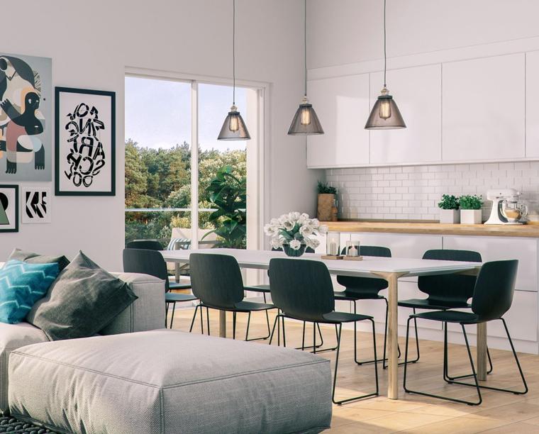 moderna e funzionale open space cucina soggiorno, con piastrelle bianche come paraschizzi, top in legno e sedie nere
