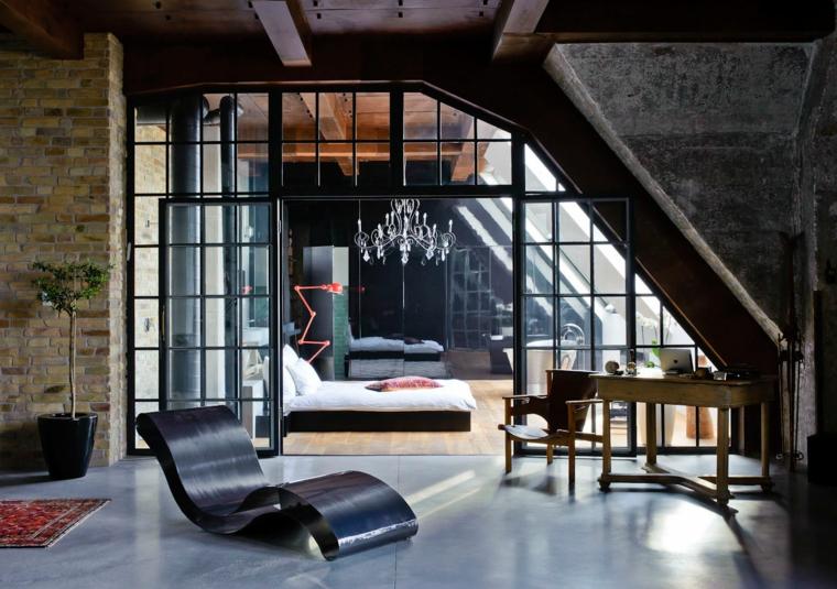 grandi vetrate con bordi neri, poltrona e letto dal design moderno, soluzione per arredare mansarda open space