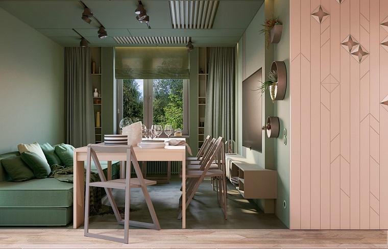 Arredare salotto e sala da pranzo insieme con divano verde e tavolo grande di legno