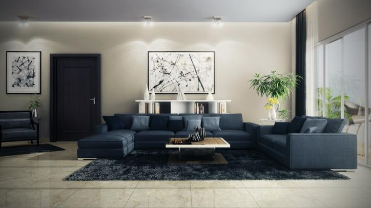 Salotti moderni con un divano blu e tavolino di legno quadrato, parete con quadri