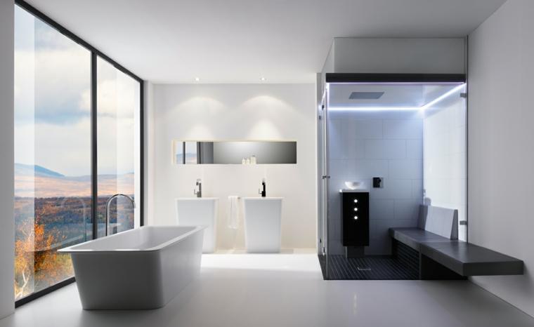 Due lavabi a colonna e vasca freestanding, docce moderne con illuminazione a led