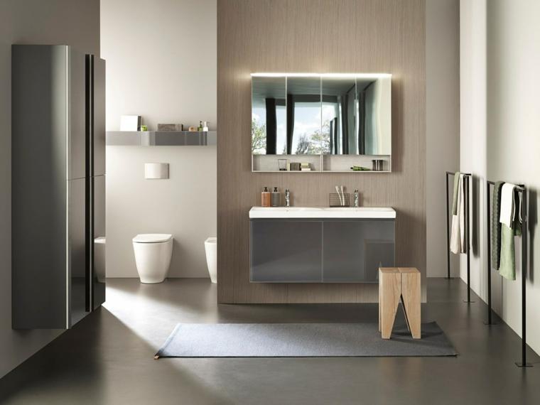 Idee bagno piastrelle di colore scuro, arredamento con armadietti e mobile lavabo sospeso