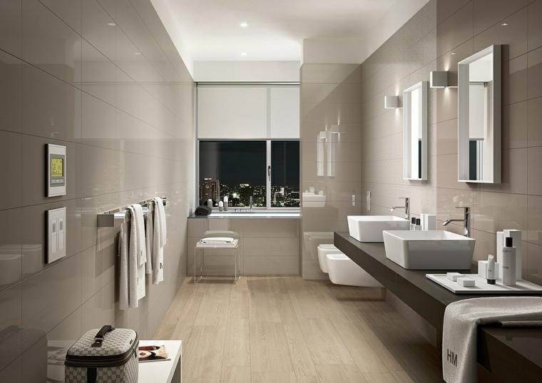 sala da bagno con pareti rivestite in piastrelle grigie abbinamenti color tortora