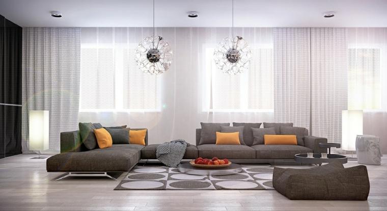 Lampadari moderni soggiorno di stile moderno con divano grigio e tavolino molto basso