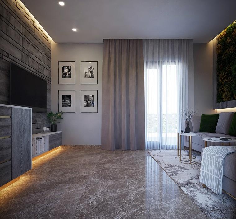 Parete attrezzata moderna per un soggiorno nella tonalità di colore grigio e illuminazione nascosta