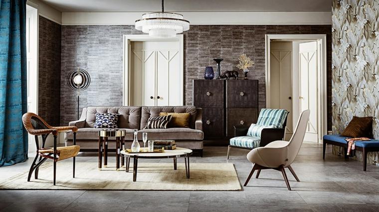 bellissimo salotto con arredamento vintage elegante con divano tortora, poltrone e rivestimento parete pietra