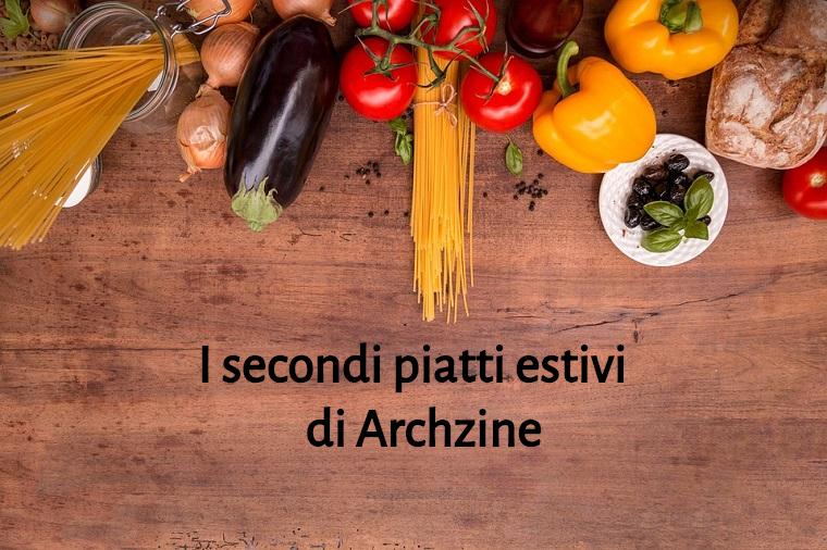 Ricette veloci estive per cena, scritta su un tavolo di legno con tante verdure e spaghetti