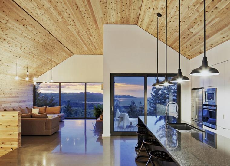 open space moderno con soffitto in legno, grandi vetrate con profilo nero e cucina a vista