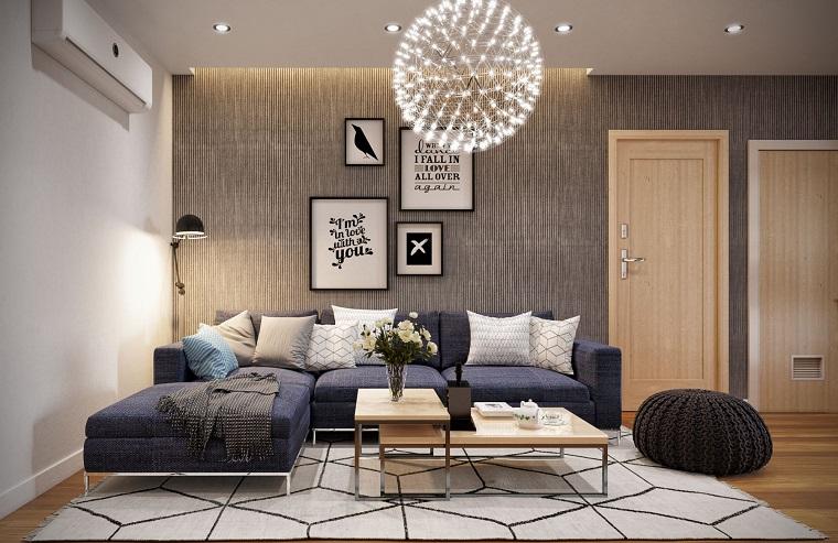 Abbinamento colori pareti, arredamento salotto con un diano penisola e tavolino ad incastro di legno
