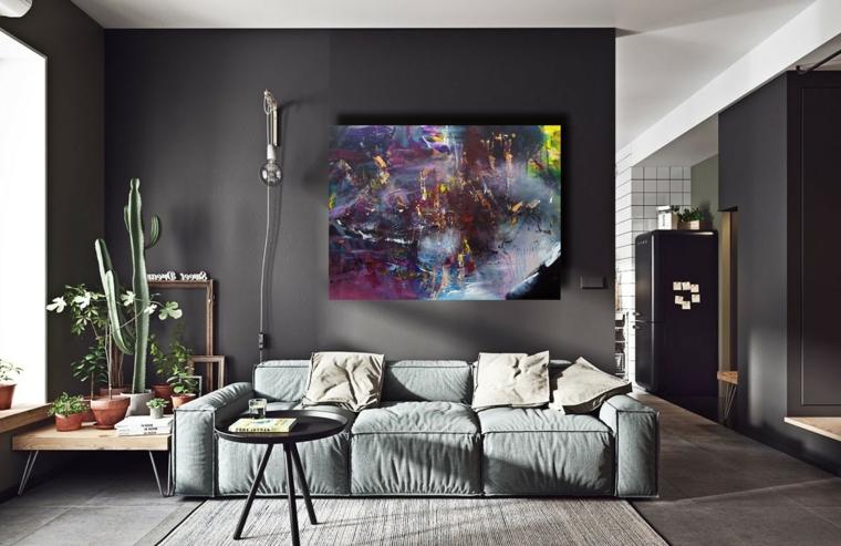 soggiorno color tortora pareti dipinte di grigio scuro divano morbido con cuscini