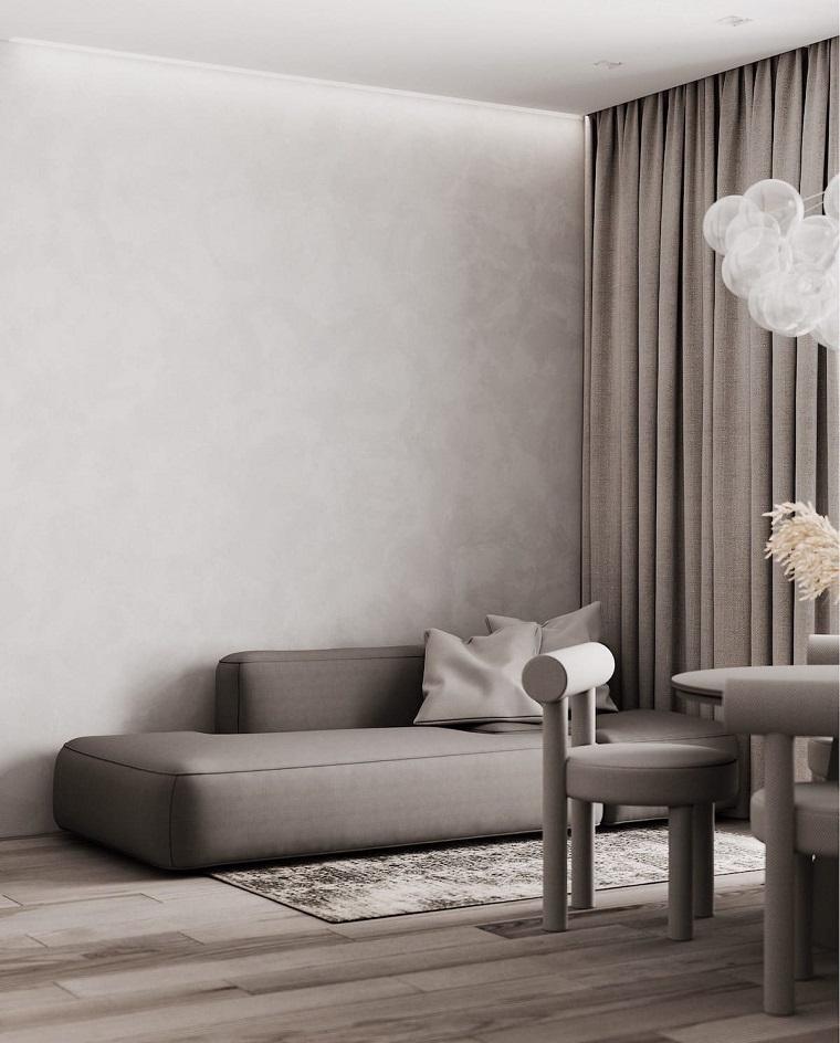 soggiorno con tende di colore tortora divano panca con morbidi cuscini