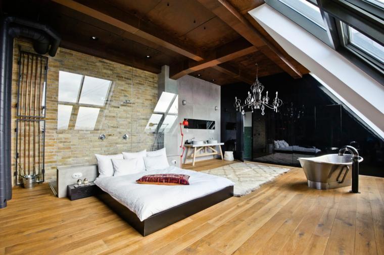 bellissima camera da letto moderna in una mansarda con vasca da bagno free standing