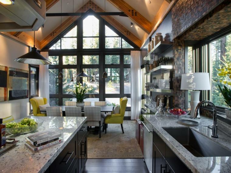open space in stile industriale con la cucina disposta sulle due pareti, il tavolo da pranzo per otto persone