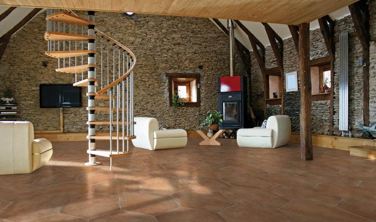 bellissimo open space moderno con muri realizzati in pietra, scala a chiocciola e divani bianchi