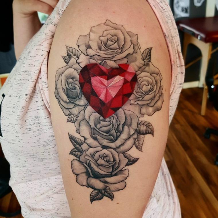 idea per tatuaggi rose braccio, tanti fiori con al centro un diamante rosso a forma di cuore