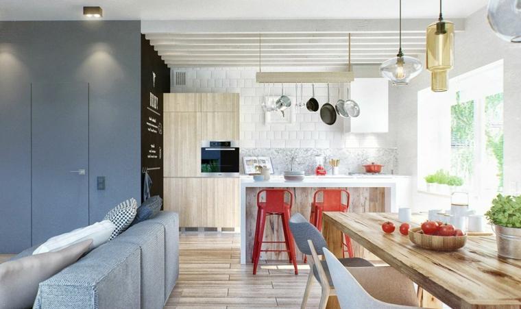 arredamento scandinavo come arredare ambiente unico cucina soggiorno con mobili in legno chiaro e divano grigio-blu