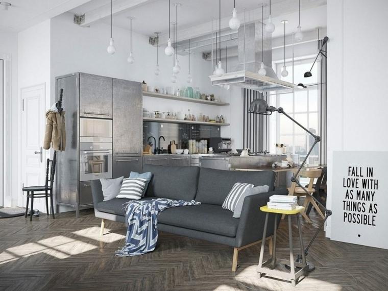 esempio di open space arredamento in stile scandinavo con divano grigio, pavimento in legno e pareti bianche
