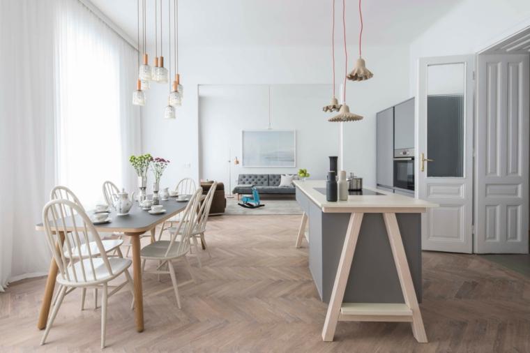 esempio di arredamento cucina moderna in stile scandinavo con tavolo da pranzo e divano grigio